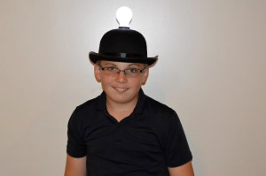 "Seventh grader Thomas D. sports a lightbulb hat for a mock episode of ""Shark Tank"" at Classical Christian Academy on April 29, 2015."