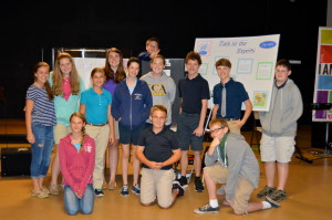 "Seventh and eighth grade students in Mrs. Shannon Schram's history class gather to present inventions during a mock episode of ""Shark Tank"" at Classical Christian Academy on April 29, 2015."