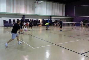 CCA parents serve against the school's team in the first volleyball Parent-Player Game.