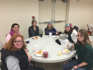 Mrs. Cotarello, in the pink scarf, joins some of her students for hot chocolate on a recent Winter Spirit Day.