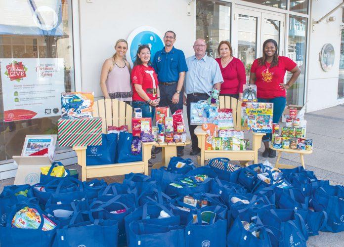 Camana-Bay-Christmas-Give-donates-to-the-Good-Samaritan-Food-Bank-696x500