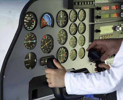 Little pilot at work. Control panel in a