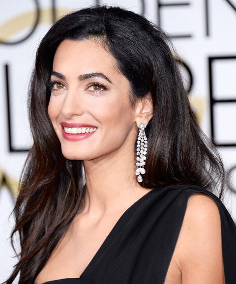 Amal Clooney wearing diamond dandling earrings
