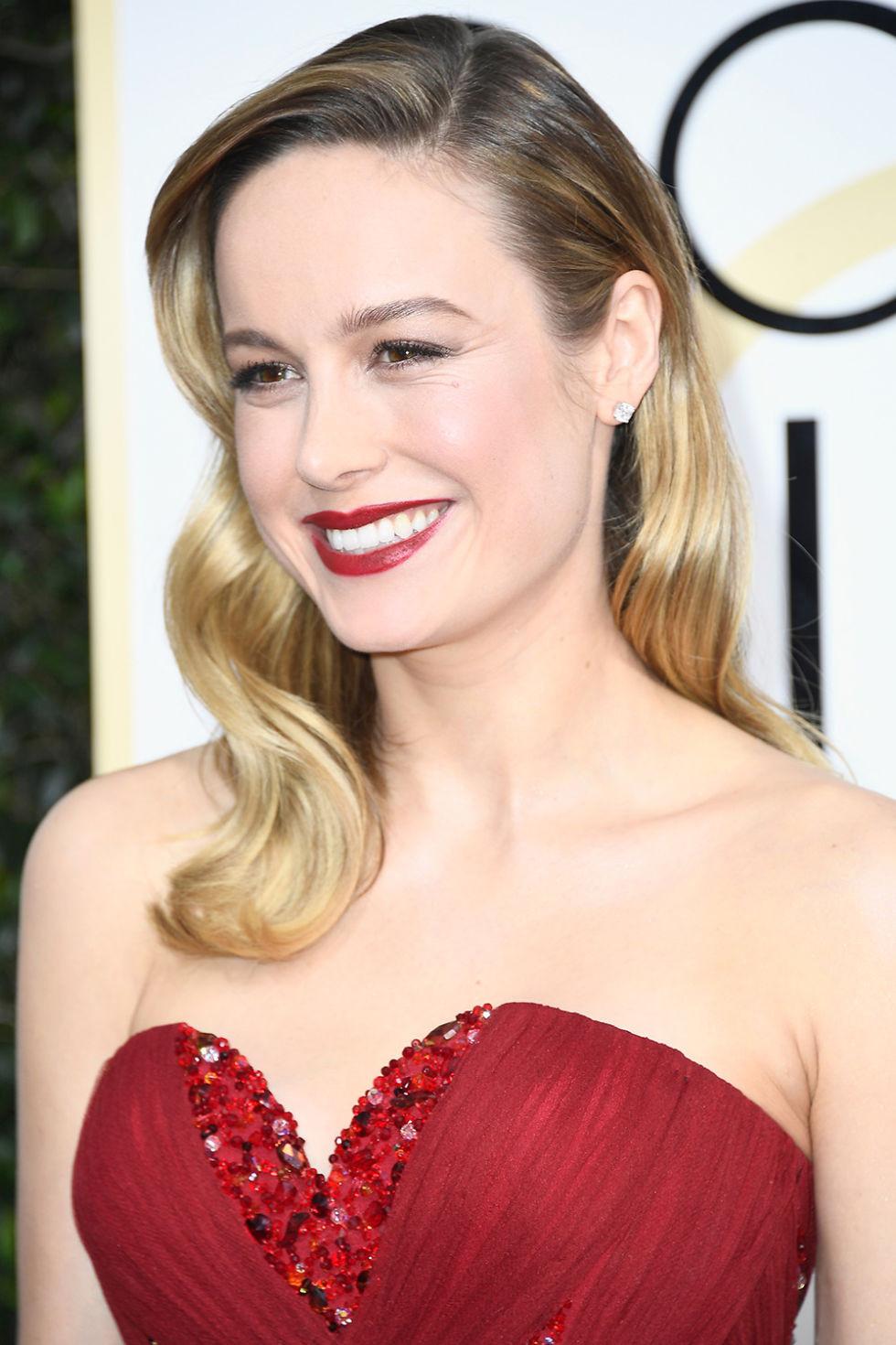 Brie Larson wearing simple stud earrings