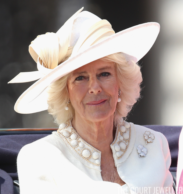 Camilla in her usual clover brooches