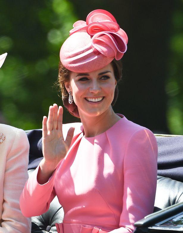 Kate wearing dandling diamond earrings