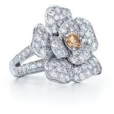Platinum flower ring with yellow & white diamonds