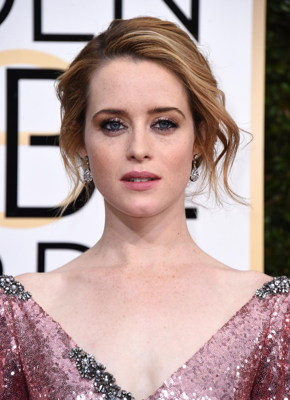 Claire Foy wearing antique diamond earrings