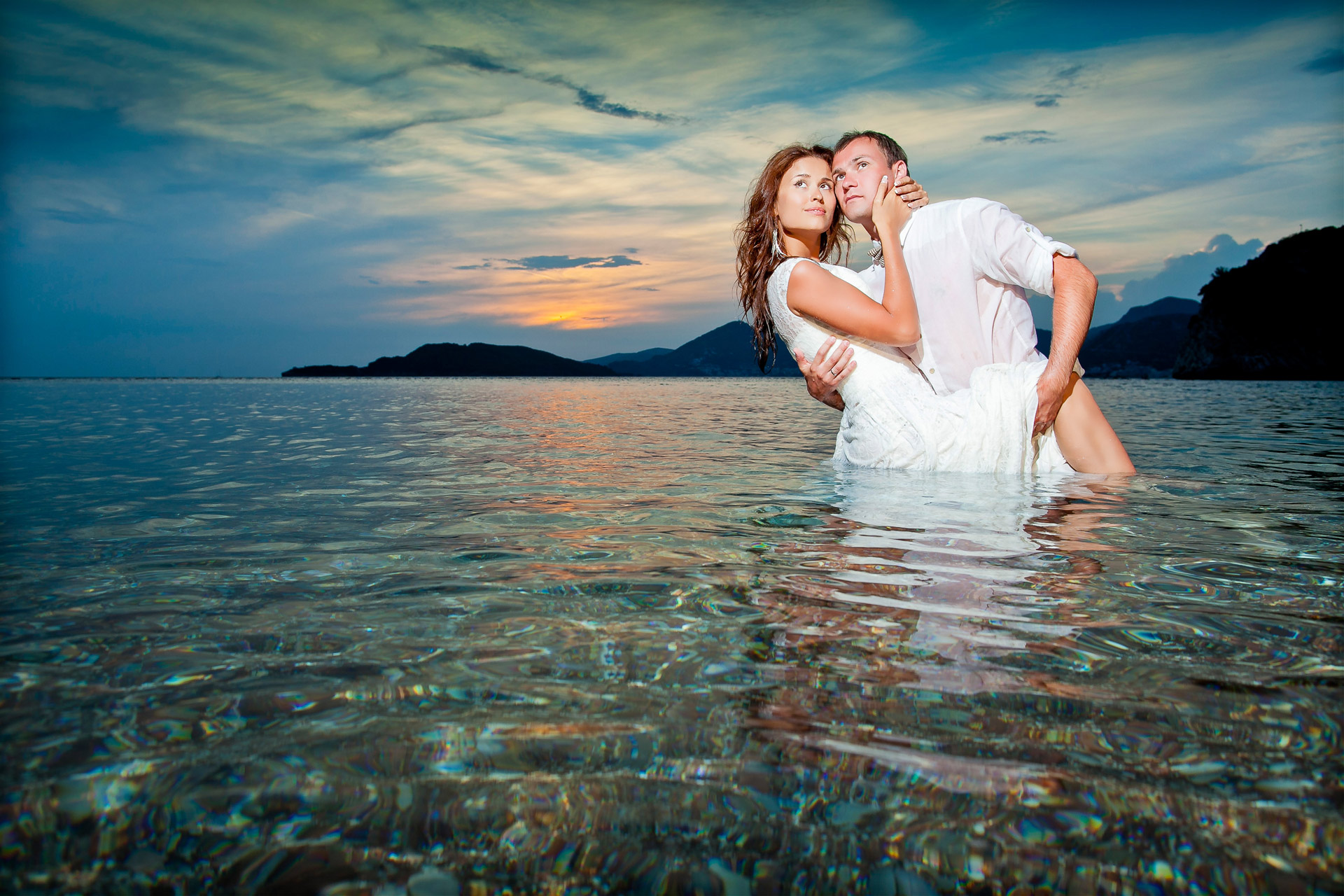 Newlyweds in water, a wedding photo