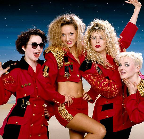 The pop punk band Fuzzbox in red uniforms.