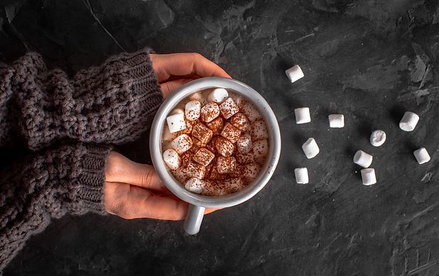 hands-holding-hot-chocolate-with-marshma