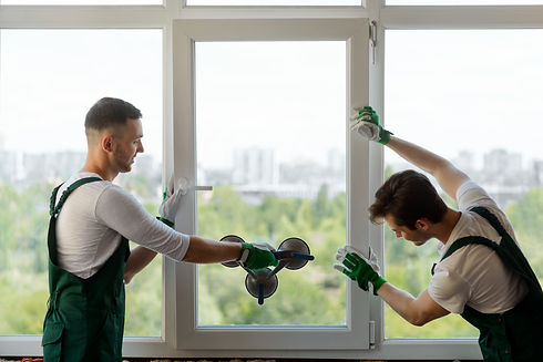 Young men mounting a window section into