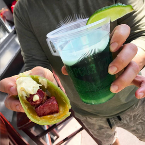 Pour Vida corned beef taco and green beer