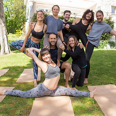 cheerful-people-from-yoga-team-posing-ou
