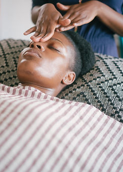 happy-ethnic-woman-enjoying-massage-in-s
