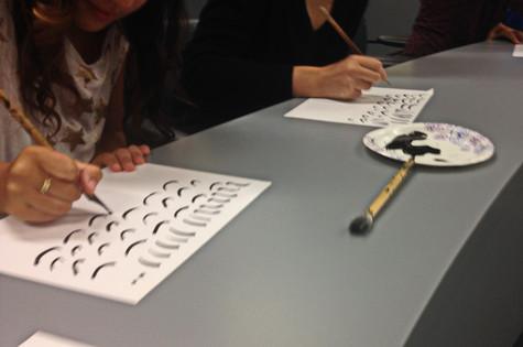 Students Practicing Arabic Script