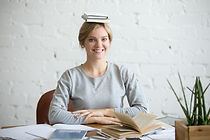 portrait-smiling-woman-desk-books-her-he