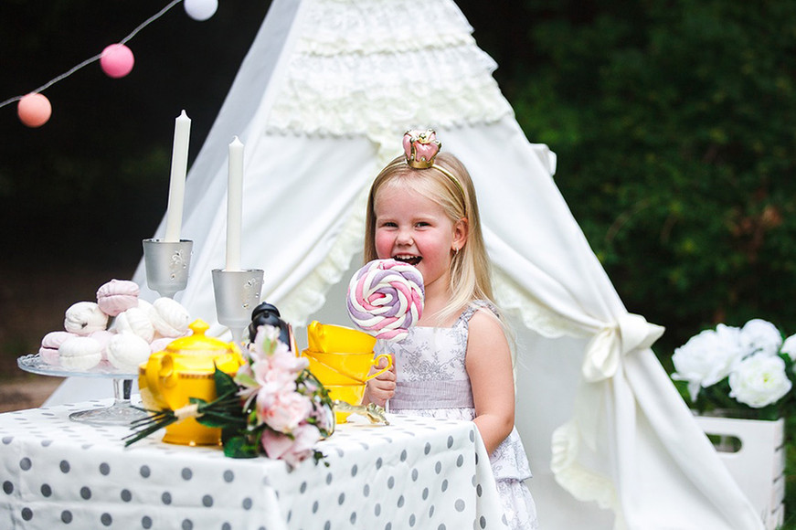 Little girl with lolli pop ivory frills teepee