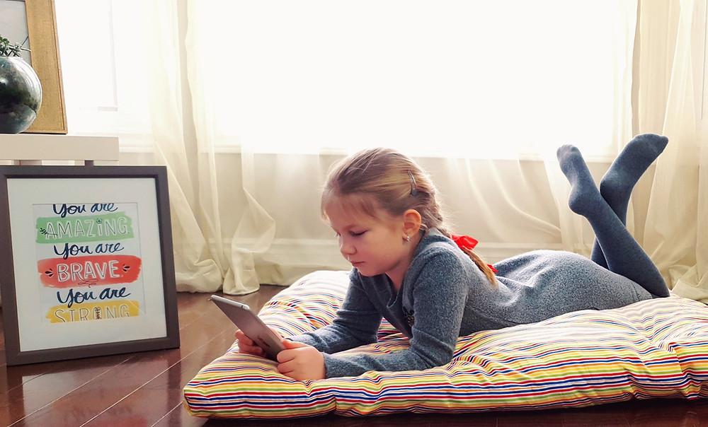 floor cushion pillow cozy corner girl boy teenager play iPad