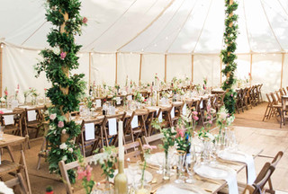 Rustic trestle tables and folding wooden chairs
