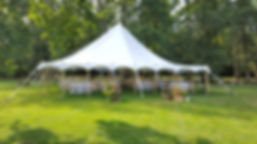 A small round marquee with no walls and bunting draped around