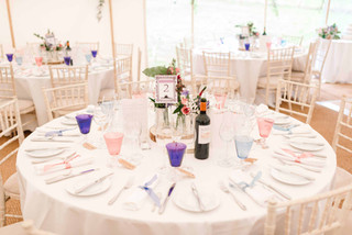 A round table with chiavari chairs laid out for a wedding