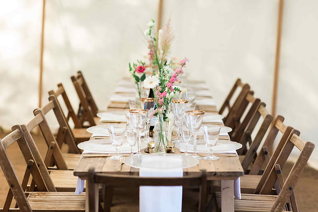 folding-chairs-trestle-table-flowers.jpg