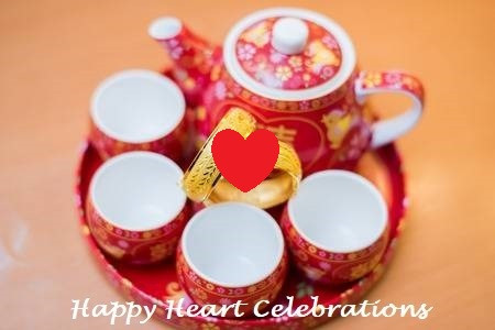 Tea Ceremony: red cups and teapot on a tray