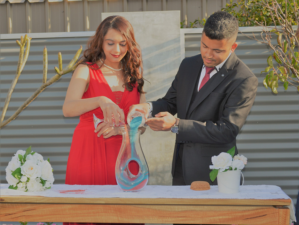 Bride & Groom pouring sand into vessel