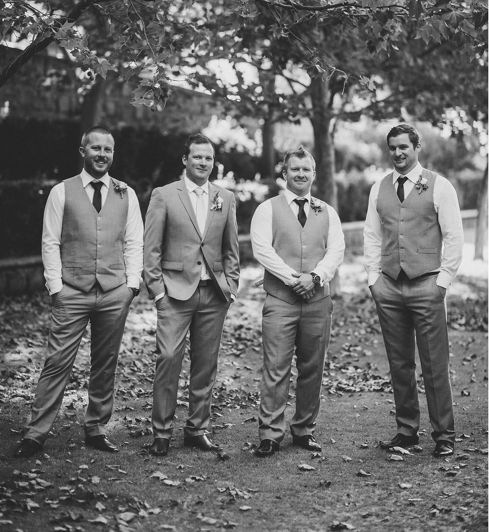 Groom and his groomsmen in a park