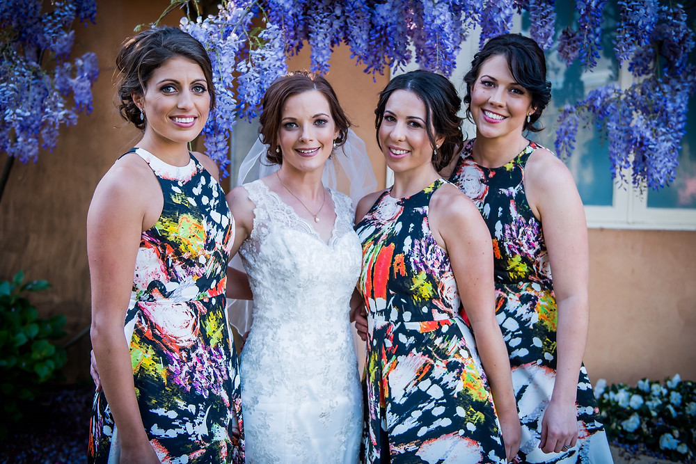 Bride and bridesmaids standing in a Row