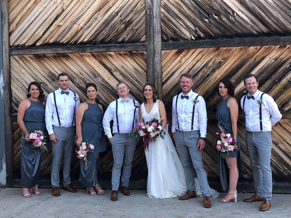 Beautiful Bride, Groom & Bridal Party in a row