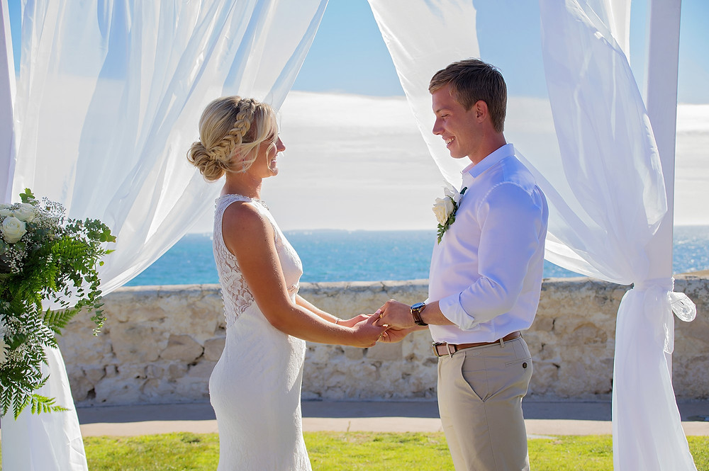 Bride & Groom at a beach setting ceremony