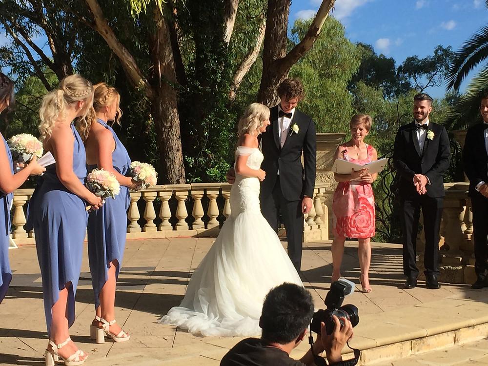 Bridal Party & Celebrant at outside wedding venue