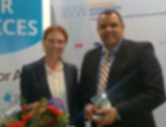 Jennifer and Oliver winning Innovation Award for UV-C LED disinfection device - PearlAqua