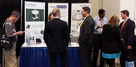 Molly and Saketh speaking to conference attendees about the PearlAqua and our disinfection technology
