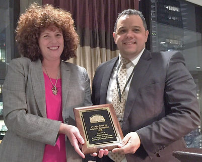 Oliver accepting the IUVA Volunteer Award and being named the IUVA President-Elect