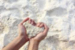 hands in sand.jpg