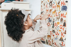 girl-pointing-on-alphabets.jpg