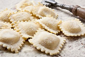 Making homemade ravioli with a wooden roller.jpg