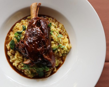 Braised Lamb Shank Served with Creamy Risotto Milanese, Lavender Jus