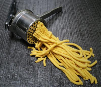 Passatelli di Imola, served with chicken broth