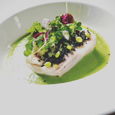 Pan fried codfish, green peas sauce and black olives