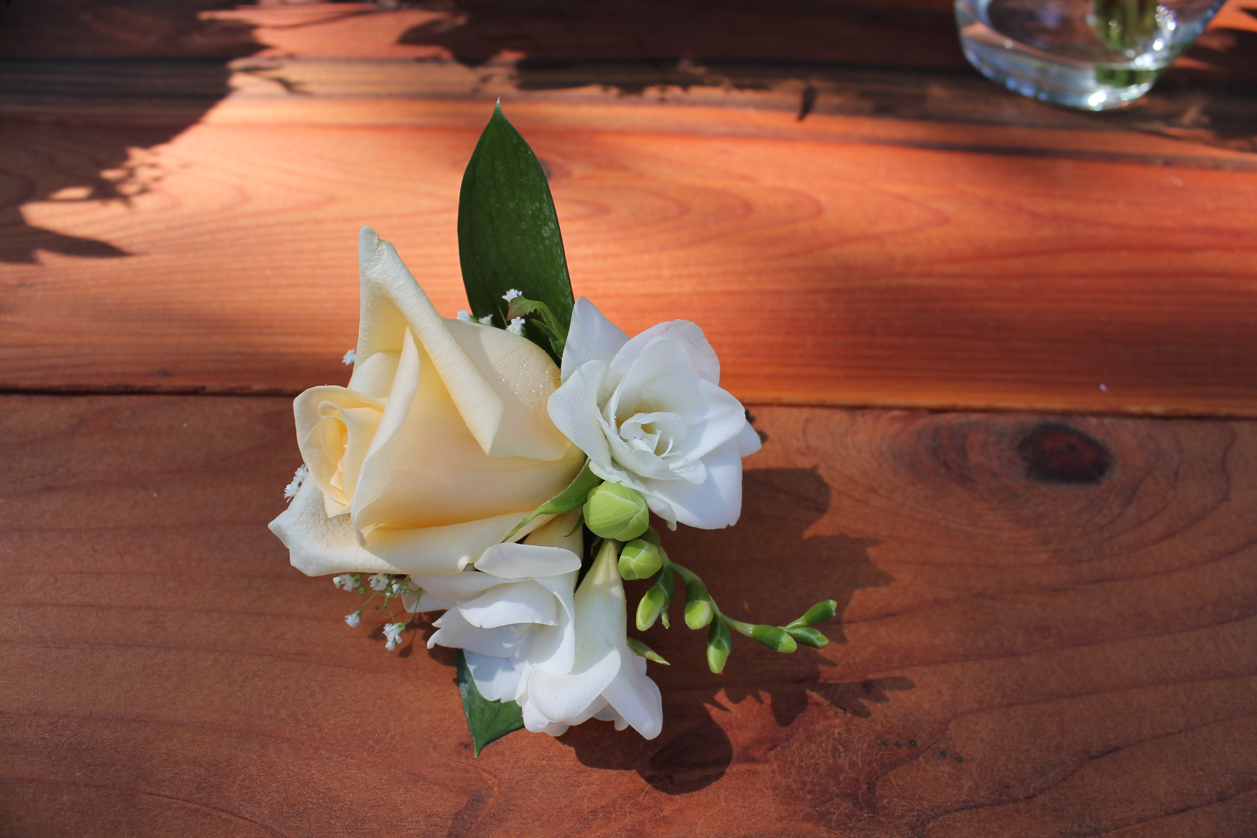 Rose corsage with fresia