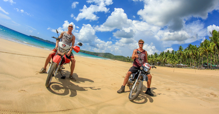 Riding motorcycle along the Nacpan Beach