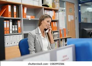 office-worker-talking-on-phone-260nw-1582992586.jpg.webp
