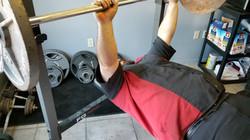 Albert lifts weights