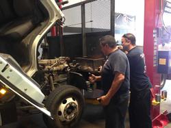 Bossman and Matt work on a truck