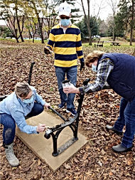 Voluteers Restoring Bench.jpg
