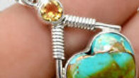 Pilot Mountain Turquoise with Topaz accent, mounted in .925 Sterling Silver.